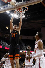 Oregon State 's Kylor Kelley (24) dunks against Southern California during the first half of an NCAA college basketball game Saturday, Feb. 23, 2019, in Los Angeles. (AP Photo/Marcio Jose Sanchez)