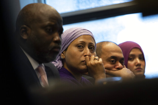 Representatives of the Rohingya community and Gambia's Justice Minister Aboubacarr Tambadou, left, listen to a testimony during a press conference in The Hague, Netherlands, Monday, Nov. 11, 2019. Gambia filed a case at the International Court of Justice in The Hague, the United Nations' highest court, accusing Myanmar of genocide in its campaign against the Rohingya Muslim minority. A statement released Monday by lawyers for Gambia says the case also asks the International Court of Justice to order measures