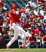 Los Angles Angels' Shohei Ohtani follows through on a foul ball against the Cincinnati Reds during the second inning of a spring training baseball game Monday, March 12, 2018, in Tempe, Ariz. (AP Photo/Matt York)