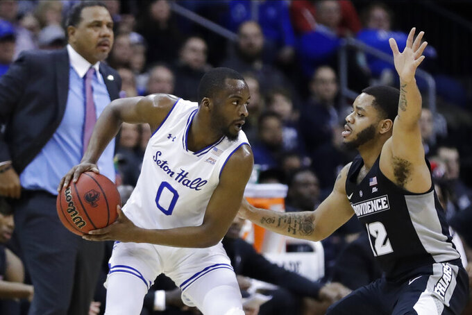 Providence's Luwane Pipkins (12) defends Seton Hall's Quincy McKnight (0) during the first half of an NCAA college basketball game Wednesday, Jan. 22, 2020, in Newark, N.J. (AP Photo/Frank Franklin II)