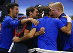 From left to right, Team Europe's Novak Djokovic, Jeremy Chardy, Roger Federer and Kyle Edmund celebrate a men's singles tennis match win against Team World's John Isner at the Laver Cup, Sunday, Sept. 23, 2018, in Chicago. (AP Photo/Jim Young)
