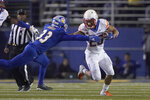 Boise State's Avery Williams (26) stiff arms San Jose State's Brendan Manigo (33) on a punt return during the first half of an NCAA college football game, in San Jose, Calif., Saturday, Nov. 2, 2019. (AP Photo/Tony Avelar)
