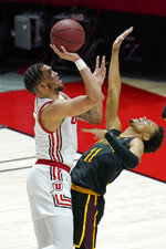 Utah forward Timmy Allen, left, shoots as Arizona State guard Alonzo Verge Jr. (11) defends in the first half during an NCAA college basketball game Saturday, March 6, 2021, in Salt Lake City. (AP Photo/Rick Bowmer)