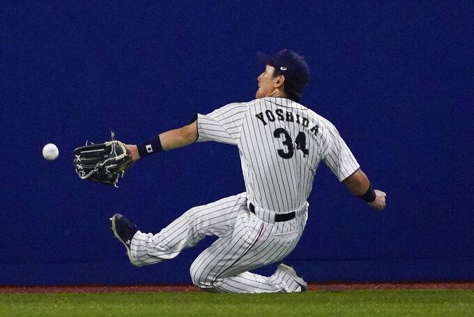 Japan's Masataka Yoshida cannot reach a ball hit by United States' Triston Casas during the seventh inning of a baseball game at the 2020 Summer Olympics, Monday, Aug. 2, 2021, in Yokohama, Japan. (AP Photo/Sue Ogrocki)