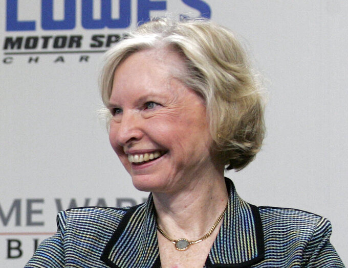 FILE - In this May 9, 2006, file photo, Janet Guthrie smiles during a press conference at Lowe's Motor Speedway in Concord, N.C. Guthrie, the first woman to qualify and compete in both the Daytona 500 and the Indianapolis 500, was dropped from the list of nominees for NASCAR's Landmark Award that honors contribution to the sport. (AP Photo/Rusty Burroughs, File)