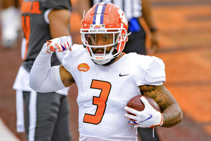 American Team wide receiver Amari Rodgers of Clemson (3) celebrates a score during the NCAA Senior Bowl college football game in Mobile, Ala., Saturday, Jan. 30, 2021. (AP Photo/Matthew Hinton)