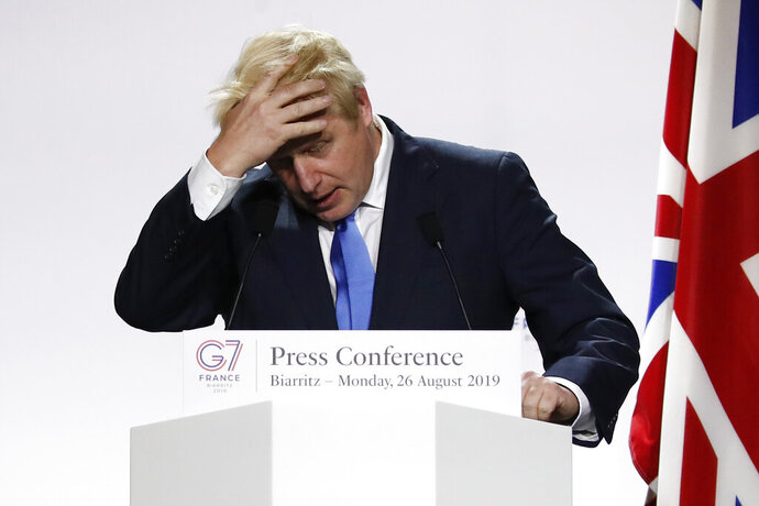 Britain's Prime Minister Boris Johnson gestures during his final press conference at the G7 summit Monday, Aug. 26, 2019 in Biarritz, southwestern France. (AP Photo/Francois Mori)