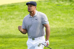 Bryson DeChambeau, of the United States, reacts after playing a shot on the fourth hole during the final round of the US Open Golf Championship, Sunday, Sept. 20, 2020, in Mamaroneck, N.Y. (AP Photo/John Minchillo)