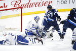 Toronto Maple Leafs goaltender Frederik Andersen (31) saves a shot from Winnipeg Jets' Tucker Poolman (3) during third-period NHL hockey game action in Winnipeg, Manitoba, Thursday, Jan. 2, 2020. (John Woods/The Canadian Press via AP)