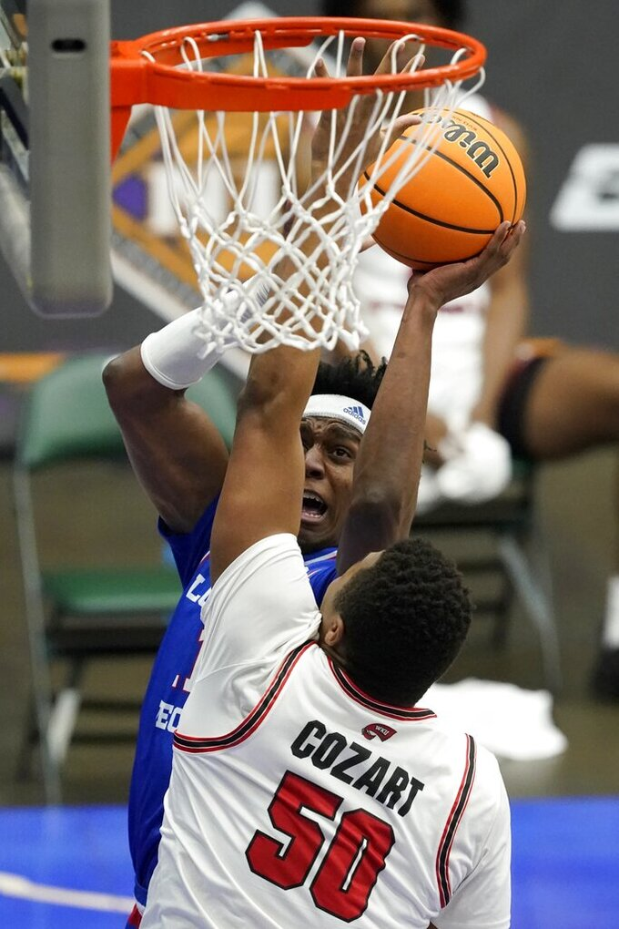 Western Kentucky forward Isaiah Cozart (50) defends against a shot by Louisiana Tech's JaColby Pemberton during the first half of an NCAA college basketball game in the quarterfinals of the NIT, Thursday, March 25, 2021, in Frisco, Texas. (AP Photo/Tony Gutierrez)
