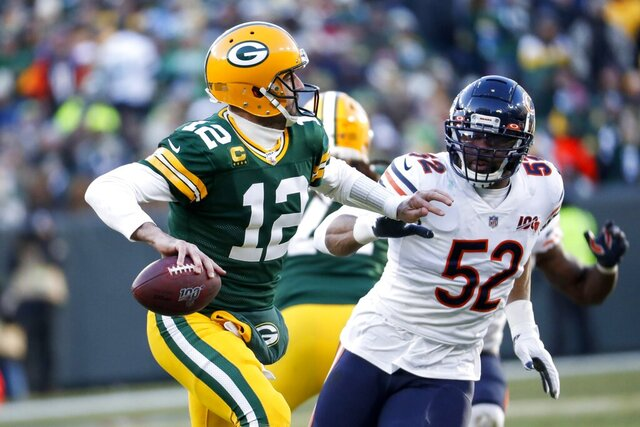 Green Bay Packers' Aaron Rodgers tries to get away from Chicago Bears' Khalil Mack during the second half of an NFL football game Sunday, Dec. 15, 2019, in Green Bay, Wis. (AP Photo/Matt Ludtke)
