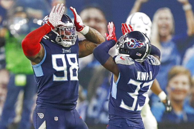 Tennessee Titans defensive tackle Jeffery Simmons (98) and cornerback Desmond King (33) celebrate after making a stop against the Indianapolis Colts in the second half of an NFL football game Thursday, Nov. 12, 2020, in Nashville, Tenn. (AP Photo/Wade Payne)