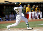 Oakland Athletics' Starling Marte (2) connects for a solo home run in the first inning of a baseball game against the Texas Rangers, Saturday, Sept. 11, 2021, in Oakland. (AP Photo/Scot Tucker)