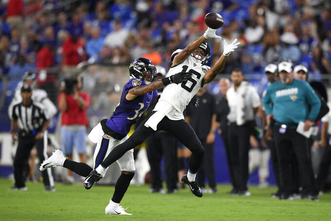 Jacksonville Jaguars wide receiver C.J. Board (16) goes up to make a catch against Baltimore Ravens cornerback Anthony Averett (34) during the first half of an NFL football preseason game Thursday, Aug. 8, 2019, in Baltimore. (AP Photo/Nick Wass)