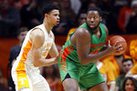Florida A&M center Evins Desir, right, works for a shot as he's defended by Tennessee forward Olivier Nkamhoua, left, during the first half of an NCAA college basketball game Wednesday, Dec. 4, 2019, in Knoxville, Tenn. (AP Photo/Wade Payne)
