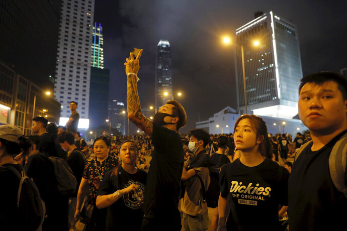 Protesters gather into the night against an unpopular extradition bill in Hong Kong on Sunday, June 16, 2019. Hong Kong citizens marched for hours Sunday in a massive protest that drew a late-in-the-day apology from the city's top leader for her handling of legislation that has stoked fears of expanding control from Beijing in this former British colony. (AP Photo/Kin Cheung)