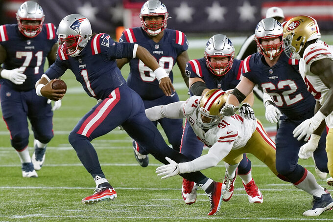 New England Patriots quarterback Cam Newton (1) runs from the grasp of San Francisco 49ers defensive end Arik Armstead (91) in the second half of an NFL football game, Sunday, Oct. 25, 2020, in Foxborough, Mass. (AP Photo/Steven Senne)