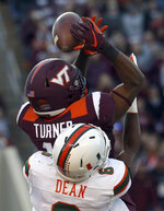 Virginia Tech receiver Tre Turner (11) has a pass from quarterback Ryan Willis knocked away by Miami defender Jhavonte Dean (6) during the first half an NCAA college football game in Blacksburg, Va., Saturday, Nov. 17 2018. (Matt Gentry/The Roanoke Times via AP)