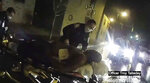 FILE- In this March 23, 2020 file image made from police body camera video provided by Roth and Roth LLP, Rochester police officers prepare to load Daniel Prude into an ambulance in Rochester, N.Y. Newly released emails show Rochester police commanders urged city officials to hold off on publicly releasing body camera footage of Daniel Prude's suffocation death because they feared violent blowback if the video came out during nationwide protests over the police killing of George Floyd. (Rochester Police via Roth and Roth LLP via AP)
