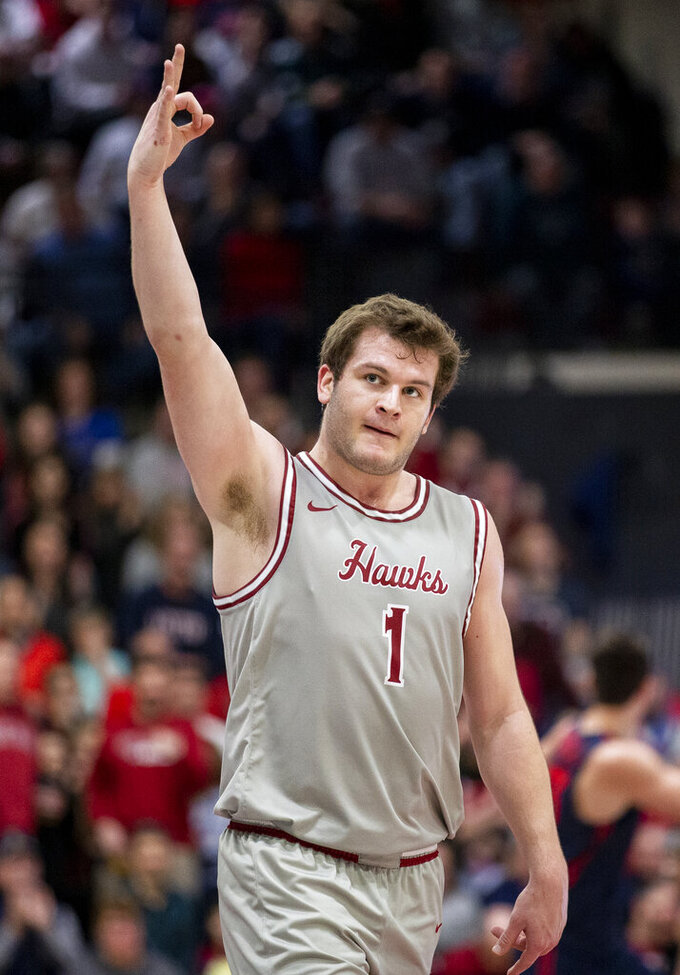 Saint Joseph's guard Ryan Daly (1) signals after hitting a three-point basket at the end of the first half of an NCAA college basketball game against Dayton, Sunday, Jan. 5, 2020, in Philadelphia. (AP Photo/Laurence Kesterson)