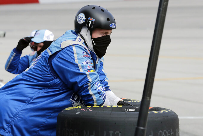 A crew member for driver Kevin Harvick watches during the NASCAR Cup Series auto race Sunday, May 17, 2020, in Darlington, S.C. (AP Photo/Brynn Anderson)