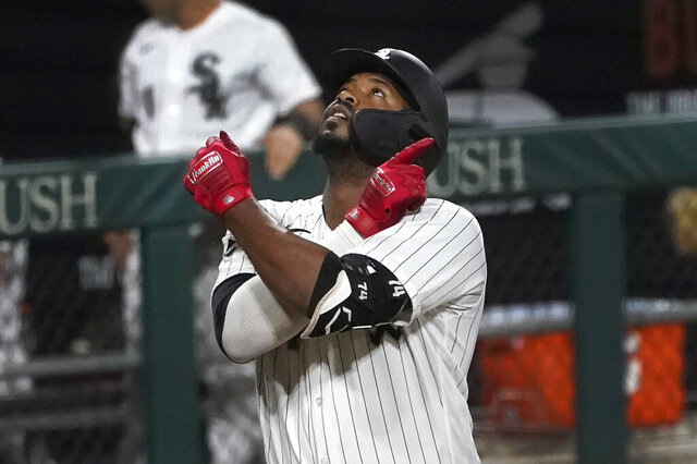 Chicago White Sox's Eloy Jimenez celebrates his three-run home run off Detroit Tigers relief pitcher Jose Cisnero during the sixth inning of a baseball game Friday, Sept. 11, 2020, in Chicago. (AP Photo/Charles Rex Arbogast)