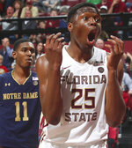 Florida State forward Mfiondu Kabengele (25) reacts after an out-of-bounds possession call goes against him as Notre Dame forward Juwan Durham (11) watches in the second half of an NCAA college basketball game in Tallahassee, Fla., Monday, Feb. 25, 2019. Florida State won 68-61. (AP Photo/Phil Sears)
