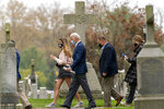 Democratic presidential candidate former Vice President Joe Biden leaves St. Joseph On the Brandywine Roman Catholic Church with his granddaughters Natalie Biden, left, and Finnegan Biden, right, Sunday, Oct. 25, 2020, in Wilmington, Del. (AP Photo/Andrew Harnik)