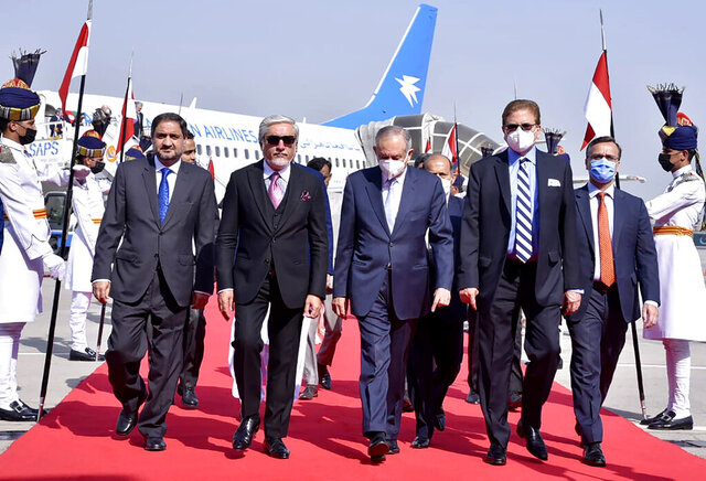 In this picture provided by Pakistan's Ministry of Foreign Affairs, Abdullah Abdullah, chairman of Afghanistan's High Council for National Reconciliation, second left, is accompanied by Pakistani officials upon his arrival at Nur Khan airbase in Rawalpindi, Pakistan, Monday, Sept. 28, 2020. Afghanistan's top official in negotiations with the Taliban arrived in Pakistan's capital Monday on a three-day trip during which he will meet with the country's prime minister and other government officials. (Ministry of Foreign Affairs via AP)
