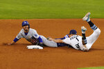 Los Angeles Dodgers' Mookie Betts steals second past Tampa Bay Rays shortstop Willy Adames during the sixth inning in Game 3 of the baseball World Series Friday, Oct. 23, 2020, in Arlington, Texas. (AP Photo/Tony Gutierrez)