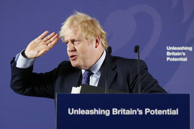 British Prime Minister Boris Johnson outlines his government's negotiating stance with the European Union after Brexit, during a key speech at the Old Naval College in Greenwich, London, Monday, Feb. 3, 2020. (AP Photo/Frank Augstein, Pool)
