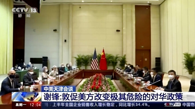"""In this image taken from a video footage run by China's CCTV via AP Video, U.S. Deputy Secretary of State Wendy Sherman, fourth left, and her delegation meet Chinese counterpart in Tianjin, China Monday, July 26, 2021. China blamed the U.S. for what it called a """"stalemate"""" in bilateral relations as high-level face-to-face talks began Monday. (CCTV via AP Video)"""