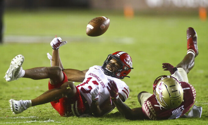 Florida State defensive back Jarrian Jones, right, (7) is called for interference on Jacksonville State wide receiver P.J. Wells (13) in the fourth quarter of an NCAA college football game Saturday, Sept. 11, 2021, in Tallahassee, Fla. Jacksonville State won 20-17. (AP Photo/Phil Sears)