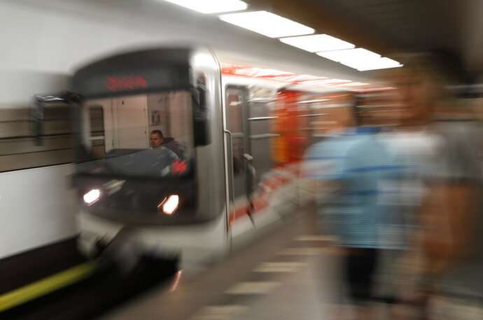 A subway train arrives at a station in Prague, Czech Republic, Tuesday, Aug. 7, 2018. Two participants in a travel competition