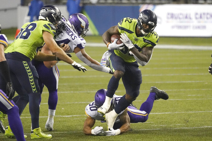Seattle Seahawks' Chris Carson (32) rushes for a touchdown against the Minnesota Vikings during the second half of an NFL football game, Sunday, Oct. 11, 2020, in Seattle. (AP Photo/Ted S. Warren)