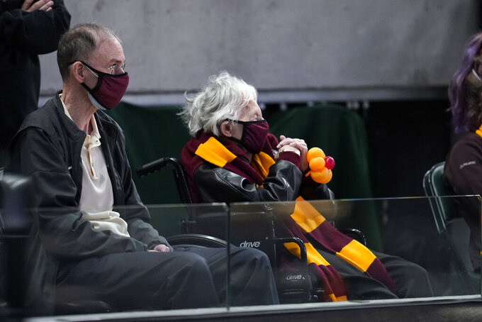 Sister Jean Dolores Schmidt watches Loyola Chicago play Illinois during the first half of a men's college basketball game in the second round of the NCAA tournament at Bankers Life Fieldhouse in Indianapolis, Sunday, March 21, 2021. (AP Photo/Paul Sancya)