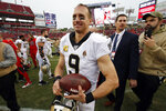 New Orleans Saints quarterback Drew Brees (9) smiles as he leaves the field after an NFL football game against the Tampa Bay Buccaneers Sunday, Nov. 17, 2019, in Tampa, Fla. (AP Photo/Mark LoMoglio)