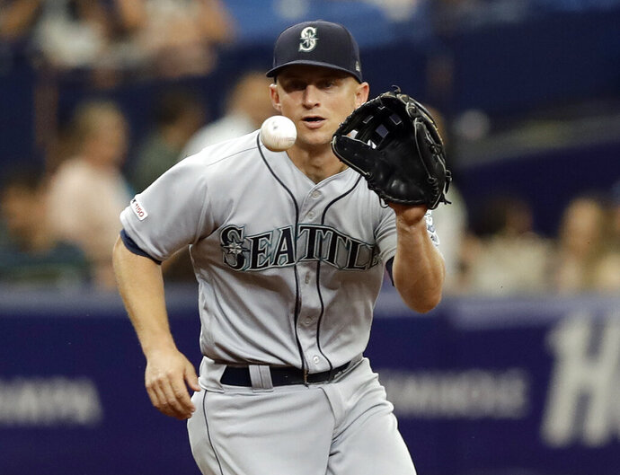 Seattle Mariners third baseman Kyle Seager fields a ground ball by Tampa Bay Rays' Michael Brosseau during the third inning of a baseball game Wednesday, Aug. 21, 2019, in St. Petersburg, Fla. Brosseau was out at first. (AP Photo/Chris O'Meara)