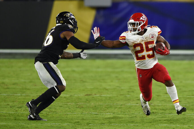 Kansas City Chiefs running back Clyde Edwards-Helaire (25) stiff arms Baltimore Ravens strong safety Chuck Clark (36) during the second half of an NFL football game, Monday, Sept. 28, 2020, in Baltimore. The Chiefs won 34-20. (AP Photo/Gail Burton)