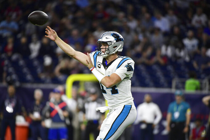 Carolina Panthers quarterback Sam Darnold throws a pass against the Houston Texans during the first half of an NFL football game Thursday, Sept. 23, 2021, in Houston. (AP Photo/Justin Rex)
