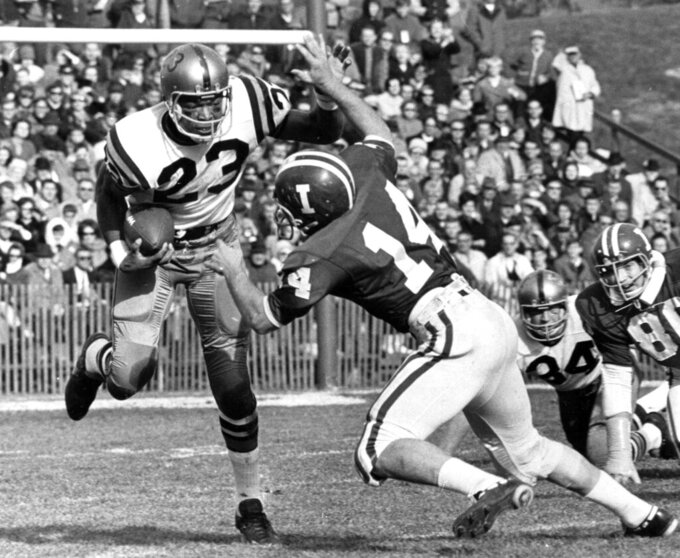 FILE - Purdue's Leroy Keyes (23) runs as Indiana's Dave Kornowa tries to make a tackle during a college football game in Bloomington, Ind., in this Nov. 25, 1967, file photo. Purdue football star Leroy Keyes, a two-time All-American and one of the greatest players in school history, has died. He was 74. Keyes' family said he died at his home in Indiana Thursday morning, April 15, 2021, surrounded by his wife and children. (Larry Crewell/The Herald-Times via AP)