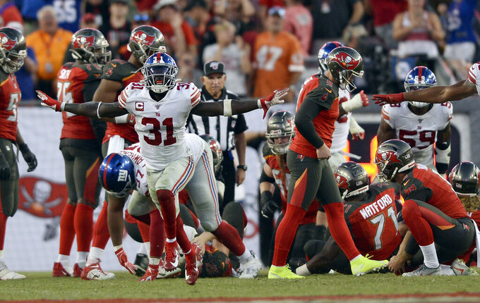New York Giants defensive back Michael Thomas, left, celebrates as Tampa Bay Buccaneers kicker Matt Gay, second from right, alks off after missing a field goal during the second half of an NFL football game Sunday, Sept. 22, 2019, in Tampa, Fla. (AP Photo/Jason Behnken)