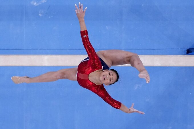 Sunisa Lee, of the United States, performs on the balance beam during the artistic gymnastics women's final at the 2020 Summer Olympics, Tuesday, July 27, 2021, in Tokyo. (AP Photo/Morry Gash)
