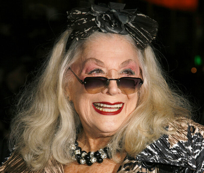 """FILE - In this Sunday, Jan. 7, 2007, file photo, Sylvia Miles arrives for the 2006 New York Film Critic's Circle Awards at the Supper Club in New York. Miles, whose brief appearances in """"Midnight Cowboy"""" and """"Farewell, My Lovely,"""" earned her two Academy Award nominations, died Wednesday, June 12, 2019. Miles was also a scene-stealing character of the New York party scene, beloved for her outgoing personality and flamboyant fashion sense. (AP Photo/Rick Maiman, File)"""