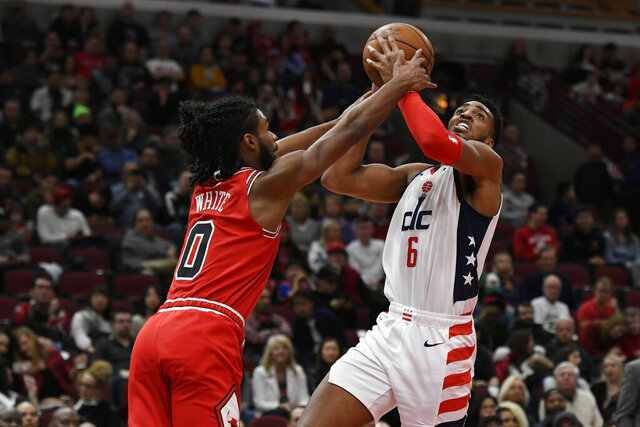 Washington Wizards' Troy Brown Jr. (6) goes up to shoot against Chicago Bulls' Coby White (0) during the first half of an NBA basketball game Sunday, Feb. 23, 2020, in Chicago. (AP Photo/Paul Beaty)