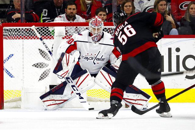 Washington Capitals goaltender Ilya Samsonov (30), of Russia, blocks the shot of Carolina Hurricanes' Erik Haula (56) during the first period of an NHL hockey game in Raleigh, N.C., Friday, Jan. 3, 2020. (AP Photo/Karl B DeBlaker)