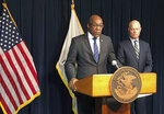 Attorney General Kwame Raoul, left, and Kane County State's Attorney Joseph McMahon hold a news conference Monday, Feb. 11, 2019, in Chicago. Raoul and McMahon, who won the conviction against Jason Van Dyke, said they believe Judge Vincent Gaughan did not properly apply the law when he sentenced Van Dyke to six years and nine months in prison. In a rare move, they filed a request with the Illinois Supreme Court seeking an order that would send the case back to Gaughan for a new sentence. (AP Photo/Noreen Nasir)