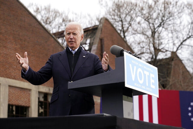 President-elect Joe Biden speaks at a drive-in rally for Georgia Democratic candidates for U.S. Senate Raphael Warnock and Jon Ossoff, Tuesday, Dec. 15, 2020, in Atlanta. (AP Photo/Patrick Semansky)