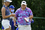 Haley Moore, right, walks to the tee on the first hole during the first round of the LPGA Pelican Women's Championship golf tournament Thursday, Nov. 19, 2020, in Belleair, Fla. (AP Photo/Chris O'Meara)
