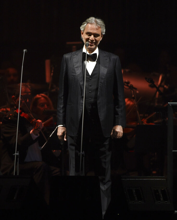 FILE - This Dec. 15, 2016 file photo shows tenor Andrea Bocelli performing with The Philharmonic of New York at Madison Square Garden in New York. Bocelli will give a solo livestreamed performance on Easter Sunday from the main historic cathedral in Milan, Italy. (Photo by Evan Agostini, File)